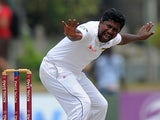 Sri Lankan cricketer Rangana Herath unsuccessfully appeals for a Leg Before Wicket (LBW) decision against unseen South Africa cricketer AB de Villiers during the fourth day of the opening Test match between Sri Lanka and South Africa at the Galle Internat
