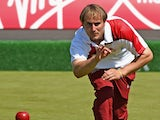 Sam Tolchard of England competes in the men's pairs at Kelvingrove Lawn Bowls Centre during day one of the Glasgow 2014 Commonwealth Games on July 24, 2014