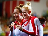 Sophie Thornhill of England and her guide Helen Scott celebrate with their gold medals during the medal ceremony for the Women's Sprint B2 Tandem Finals at Sir Chris Hoy Velodrome during day one of the Glasgow 2014 Commonwealth Games on July 24, 2014
