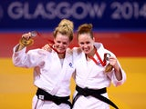 Silver medalist Stephanie Inglis of Scotland and bronze medalist Connie Ramsay of Scotland pose on the podium during the Women's -57kg medal ceremony at SECC Precinct during day one of the Glasgow 2014 Commonwealth Games on July 24, 2014