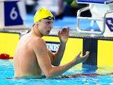 Australia's Thomas Fraser-Holmes celebrates winning gold in the men's 200m freestyle final on July 25, 2014