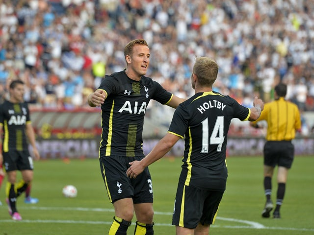 Harry Kane #37 (L) and Lewis Holtby #14 of Tottenham Hotspur celebrate Kane's goal against the Chicago Fire during the first half at Toyota Park on July 26, 2014