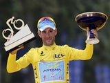Tour de France 2014's winner Italy's Vincenzo Nibali poses on the podium on the Champs-Elysees avenue in Paris, at the end of the 137.5 km twenty-first and last stage of the 101st edition of the Tour de France cycling race on July 27, 2014
