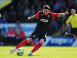Adam Hammill of Huddersfield Town in action during the Sky Bet Championship match between Yeovil Town and Huddersfield Town at Huish Park on April 21, 2014