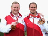 Andrew Knapper (L) and Sam Tolchard (R) of England celebrate with their bronze medals after the Men's Pairs Final on July 28, 2014