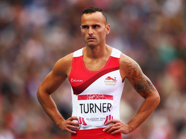 A dejected Andy Turner of England looks on after failing to finish in Men's 110 metres hurdles Round 1 at Hampden Park during day six of the Glasgow 2014 Commonwealth Games on July 29, 2014