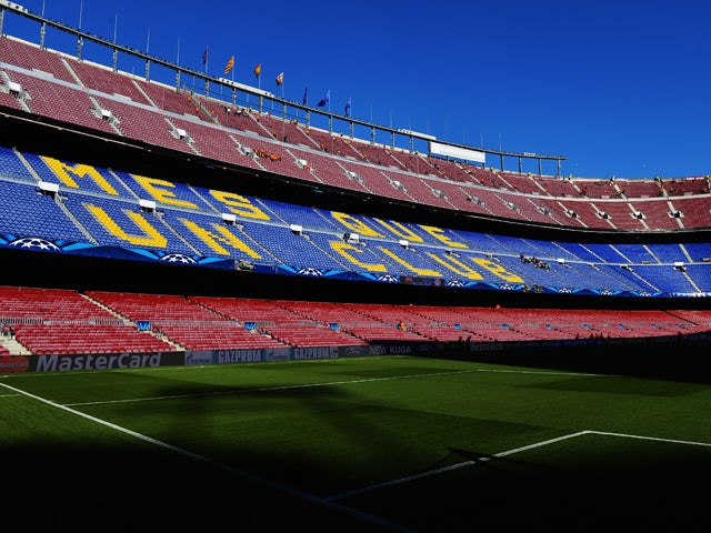 Barca notches win in empty stadium