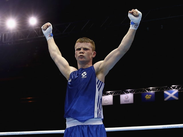 Charlie Flynn of Scotland celebrates after winning the Men's Light 60kg Semi-Finals Boxing at Scottish Exhibition And Conference Centre during day nine of the Glasgow 2014 Commonwealth Games on August 1, 2014