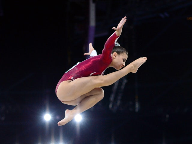 Claudia Fragapane of England performs on the beam during the Women's All-Around final of the Artistic Gymnastics event during the 2014 Commonwealth Games in Glasgow, Scotland, on July 30, 2014
