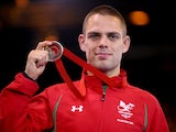 Craig Pilling of Wales celebrates with his medal after the 57kg Freestyle Wrestling Bronze medal match at Scottish Exhibition And Conference Centre during day six of the Glasgow 2014 Commonwealth Games on July 29, 2014