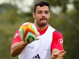 French rugby player Damien Chouly (R) throws the ball during the first training session at Anglican Church Grammar School in Brisbane, May 30, 2014