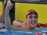Wales' Daniel Jervis react after taking gold and bronze in the Men's 1500m Freestyle Final on July 29, 2014