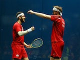 Daryl Selby and James Willstrop of England celebrate victory in the Men's Doubles Bronze Medal Match against Alan Clyne and Harry Leitch of Scotland at Scotstoun Sports Campus during day eleven of the Glasgow 2014 Commonwealth Games on August 3, 2014