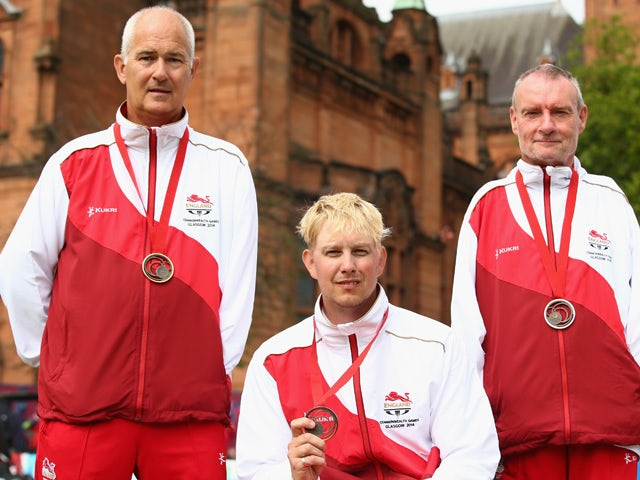 David Fisher, Paul Brown and Bob Love of England pose with their bronze medals won in the Para-Sport Open Triples B6/B7/B8 lawn bowls at Kelvingrove Lawn Bowls Centre during day eight of the Glasgow 2014 Commonwealth Games on July 31, 2014
