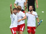 Adam Dixon of Engalnd celebrates after scoring a goal during the men's preliminaries match between New Zealand and England at the Glasgow National Hockey Centre during day six of the Glasgow 2014 Commonwealth Games on July 29, 2014