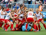Goalkeeper Maddie Hinch of England is mobbed by her teammates as she saves the deciding penalty shuttle to put England through to the Gold Medal final during the Women's Hockey Semi Final between New Zealand and England at Glasgow National Hockey Centre d