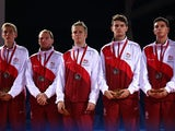 Andrew Baggaley, Paul Drinkhall, Liam Pitchford, Danny Reed, and Sam Walker of Team England pose with their Silver Medals after winning the Silver Medal in the Men's Team Table Tennis Final between Singapore and England at Scotstoun Sports Campus during d