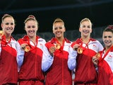 The England women's gymnastics team pose with their medals after winning gold in the team gymnastics at the SECC Precinct during the 2014 Commonwealth Games in Glasgow on July 29, 2014