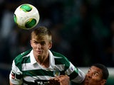 Sporting's English defender Eric Dier vies with Maritimo's Brazilian forward Derley during the Portuguese league football match Sporting CP vs SC Maritimo at Jose Alvalade stadium in Lisbon on November 2, 2013
