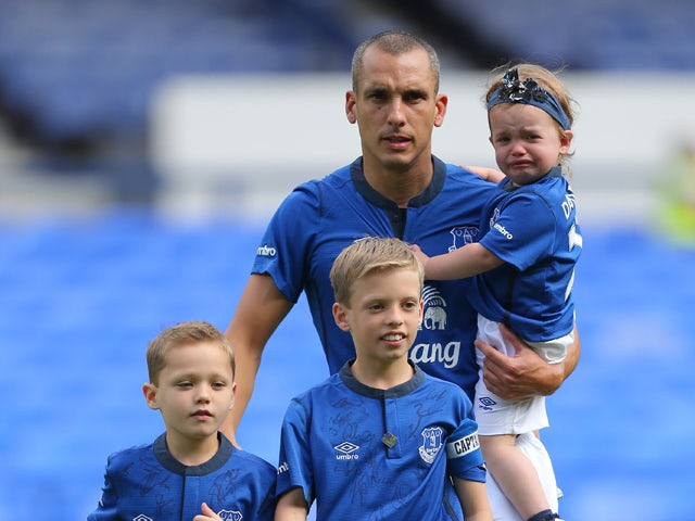 Leon Osman of Everton arrives on the pitch with his children for his testimonial match, the Pre-Season Friendly between Everton and Porto at Goodison Park on August 3, 2014