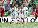 Tjaronn Chery of Groningen is congratulated by team mates after scoring the first goal of the game during the pre season friendly match between FC Groningen and Aston Villa held at the Euroborg on August 2, 2014