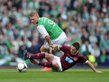 Garry O'Connor of Hibernian tackles Ian Black of Hearts during the William Hill Scottish Cup final between Hibernian and Hearts at Hampden Park on May 19, 2012