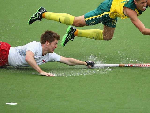 Henry Weir of England reaches for the ball in the Men's Semi-Final match between Australia and England at Glasgow National Hockey Centre during day ten of the Glasgow 2014 Commonwealth Games on August 2, 2014
