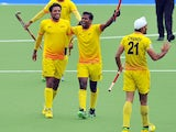 India's Gurbaj Singh and Danish Mujtaba celebrate winning their men's semi-final field hockey match between New Zealand and India at the Glasgow National Hockey Centre during the 2014 Commonwealth Games in Glasgow, Scotland, on August 2, 2014
