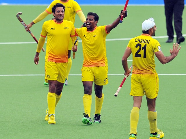 India battle back to book place in final