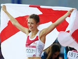 Isobel Pooley celebrates with the England flag after winning silver in the women's high jump on August 1, 2014