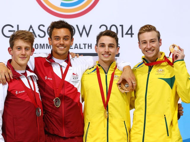 James Denny and Tom Daley of England pose with their silver medals next to gold medallists Domonic Bedggood and Matthew Mitcham of Australia after the men's synchronised 10m platform final at the Commonwealth Games on August 1, 2014