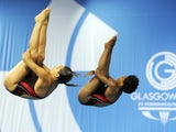 Jennifer Abel and Pamela Ware of Canada compete in the Women's Synchronised 3m Springboard Diving Competition in the 2014 Commonwealth Games at the Royal Commonwealth Pool in Edinburgh, Scotland on July 30, 2014