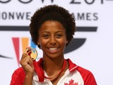 Gold medalist Jennifer Abel of Canada poses during the medal ceremony for the Women's 1m Springboard Final at Royal Commonwealth Pool during day nine of the Glasgow 2014 Commonwealth Games on August 1, 2014