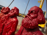 Red Karl Marx sculptures of artist Ottmar Hoerl are pictured at a company in Trier, Germany on April 4 , 2013