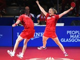 Kelly Sibley and Danny Reed of England celebrate winning the bronze medal following their Mixed Doubles Bronze Medal Match against Jian Zhan and Tianwei Feng of Singapore at Scotstoun Sports Campus during day ten of the Glasgow 2014 Commonwealth Games on