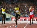 Kemar Bailey-Cole of Jamaica crosses the finish line of the men's 100m ahead of England's Adam Gemili on July 28, 2014