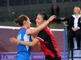 Gold medalist Michelle Li of Canada is congratulated by Kirsty Gilmour of Scotland following the Women's Singles Gold Medal Match at Emirates Arena during day eleven of the Glasgow 2014 Commonwealth Games on August 3, 2014