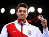 Silver medalist Kristian Thomas of England poses during the medal ceremony for the Men's Vault Final at SSE Hydro during day nine of the Glasgow 2014 Commonwealth Games on August 1, 2014
