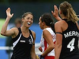 Krystal Forgesson of New Zealand celebrates with Olivia Merry after scoring a goal during the Women's preliminaries match between New Zealand and Canada at Glasgow National Hockey Centre during day seven of the Glasgow 2014 Commonwealth Games on July 30,
