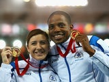 Gold medalist Libby Clegg of Scotland and her guide Mikail Huggins on the podium during the medal ceremony for the Women's 100m T12 Finalat Hampden Park during day five of the Glasgow 2014 Commonwealth Games on July 28, 2014