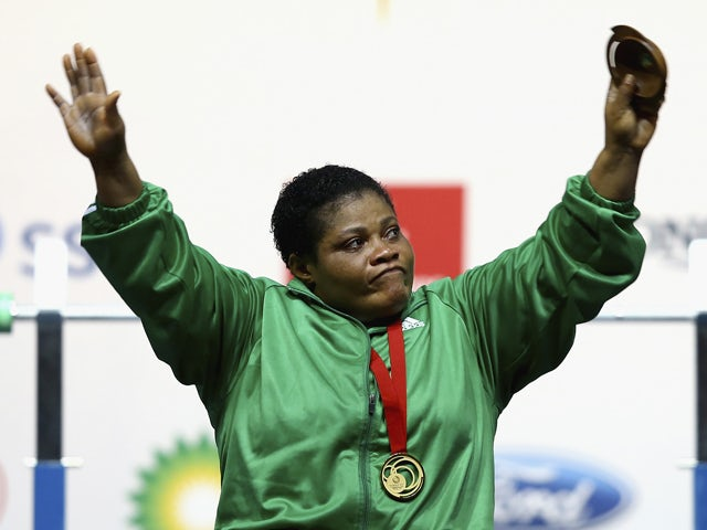 Gold Medalist Loveline Obiji of Nigeria after winning the Women's Heavyweight Powerlifting at Scottish Exhibition And Conference Centre during day ten of the Glasgow 2014 Commonwealth Games on August 2, 2014