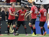 Ashley Young #18 of Manchester United celebrates his first half goal against Real Madrid with Michael Keane #38, Wayne Rooney #10 and Phil Jones #4, left, during the Guinness International Champions Cup at Michigan Stadium on August 2, 2014