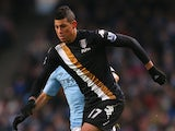 Matthew Briggs of Fulham runs with the ball during the Barclays Premier League match between Manchester City and Fulham at Etihad Stadium on January 19, 2013