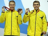 Matthew Mitcham and Grant Nel of Australia pose with their silver medals after finishing second in the synchronised 3m platform final at the Commonwealth Games on August 1, 2014