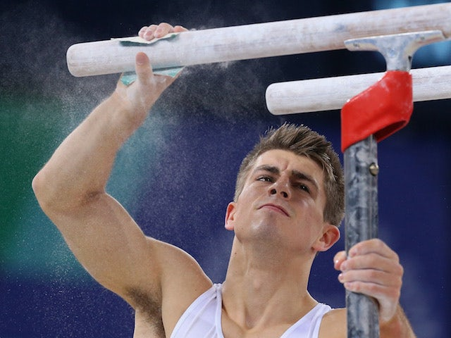 Max Whitlock of England prepares to compete on the parallel bars during day two of the Commonwealth Games men's artistic gymnastics team final on July 29, 2014