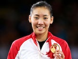 Gold medalist Michelle Li of Canada poses in the medal ceremony for the Women's Singles Gold Medal Match at Emirates Arena during day eleven of the Glasgow 2014 Commonwealth Games on August 3, 2014