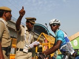 Cyclists Sesay Moses Lansana talks to security at the Athletes Village ahead of the Delhi 2010 Commonwealth Games on October 1, 2010