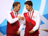 England diving duo Nick Robinson-Baker and Freddie Woodward celebrate on the podium after winning Commonwealth Games bronze in the synchronised 3m final on August 1, 2014