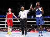 England's Nicola Adams celebrates winning against Northern Ireland's Michaela Walsh during their women's fly (48-51kg) final boxing match at the 2014 Commonwealth Games in Glasgow, Scotland, on August 2, 2014