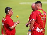Paul Taylor and Jonathan Tomlinson and Marc Wyatt of Wales compete against Scotland in the Men's Triples round 5 match against Australia at Kelvingrove Lawn Bowls Centre during day three of the Glasgow 2014 Commonwealth Games on July 26, 2014